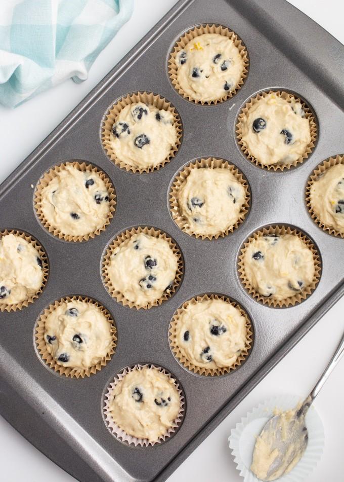 Muffin batter in muffin tin.