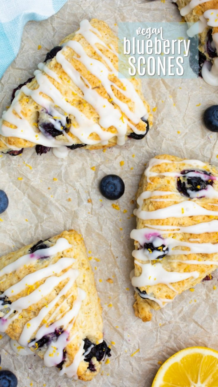 The best vegan blueberry scones are loaded with fresh blueberries and topped with a sweet/tart lemon icing! These homemade scones are quick and easy to make and require only 7 ingredients. Whip up a batch for a weekend breakfast, a holiday gathering, or keep it simple and enjoy them with a morning cup of coffee. #vegan #blueberries #scones #veganscones #veganbaking #plantbased