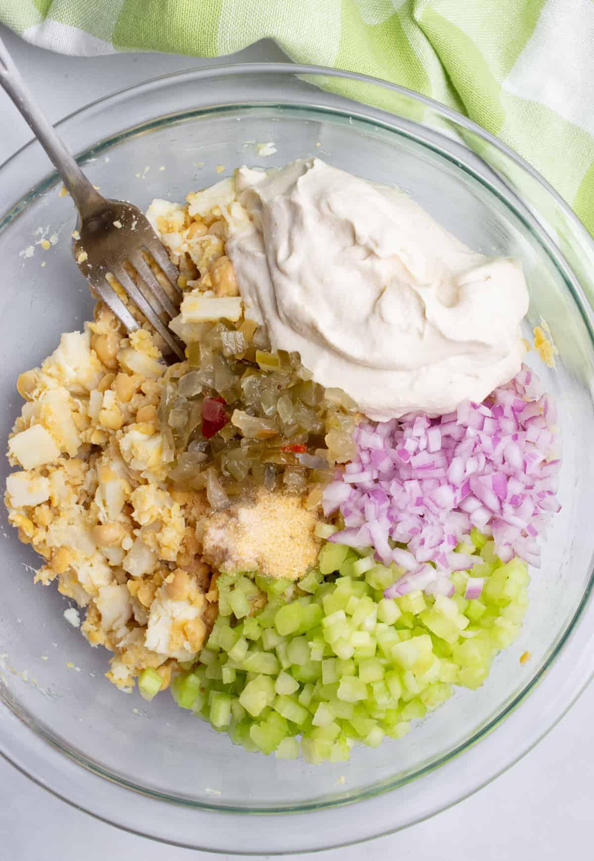 A bowl of vegan tuna salad ingredients.