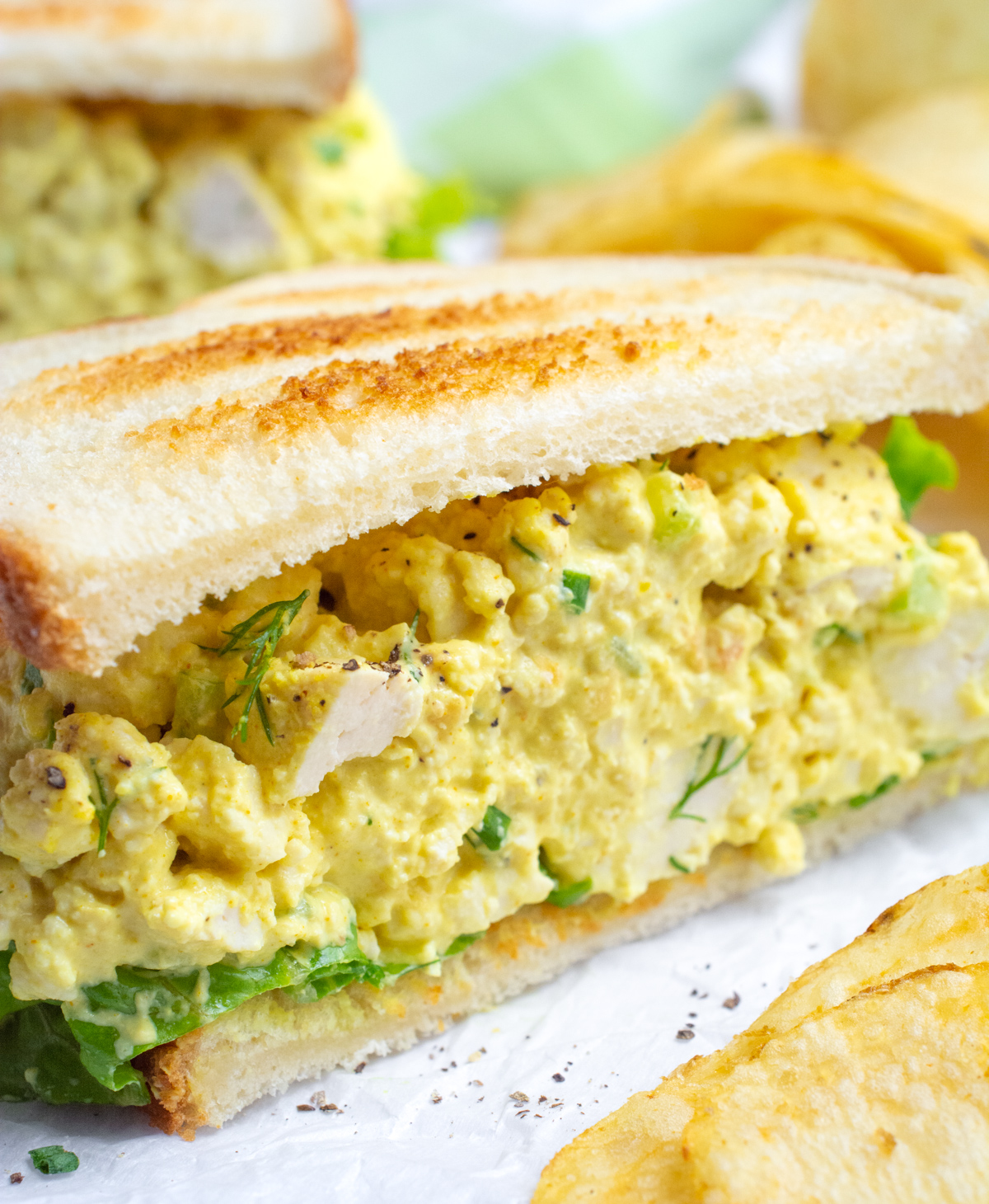 Half of a vegan egg salad sandwich.