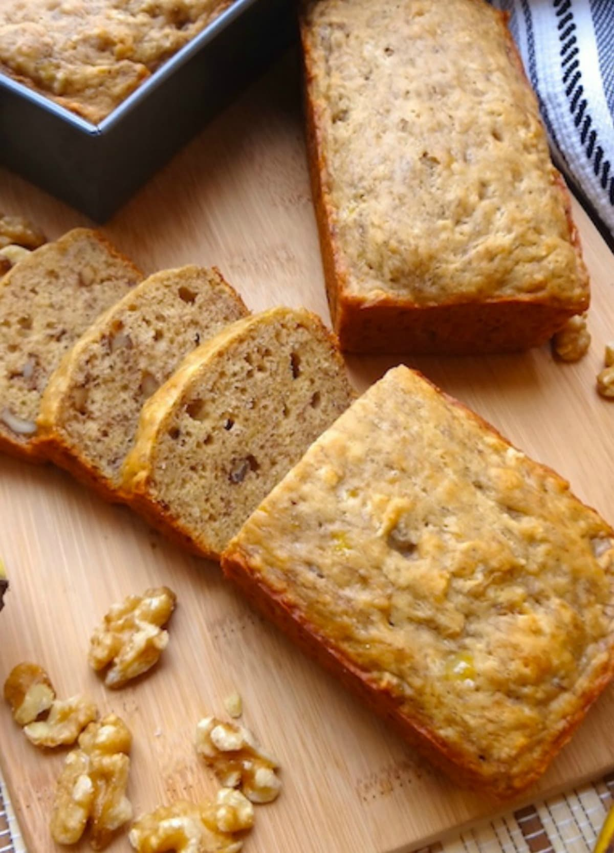 Close up of vegan banana bread with 3 slices cut.