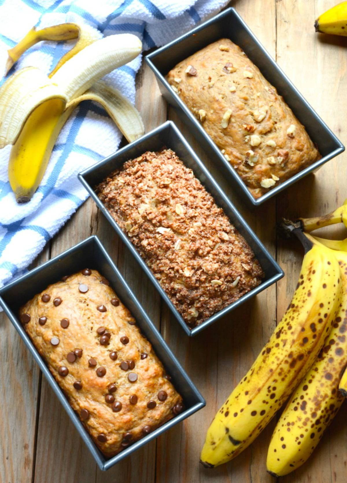 3 mini loaves of vegan banana bread. One with chocolate chips, one with cinnamon and one with walnuts.
