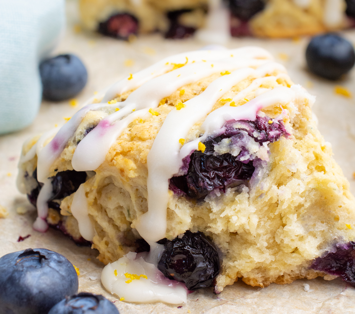 A blueberry scone broken into to show the inside.