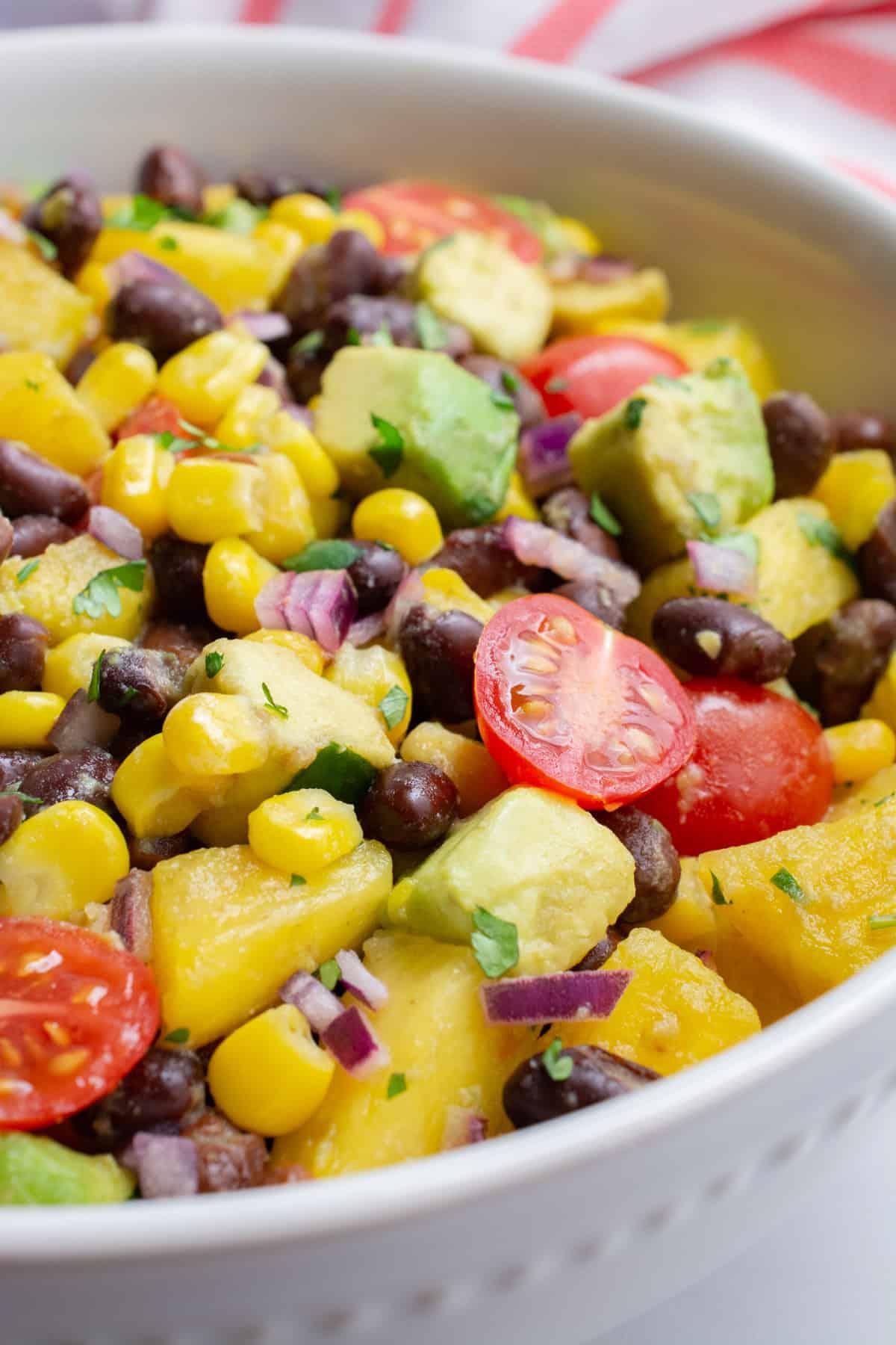 A closeup of a bowl of pineapple black bean salad.