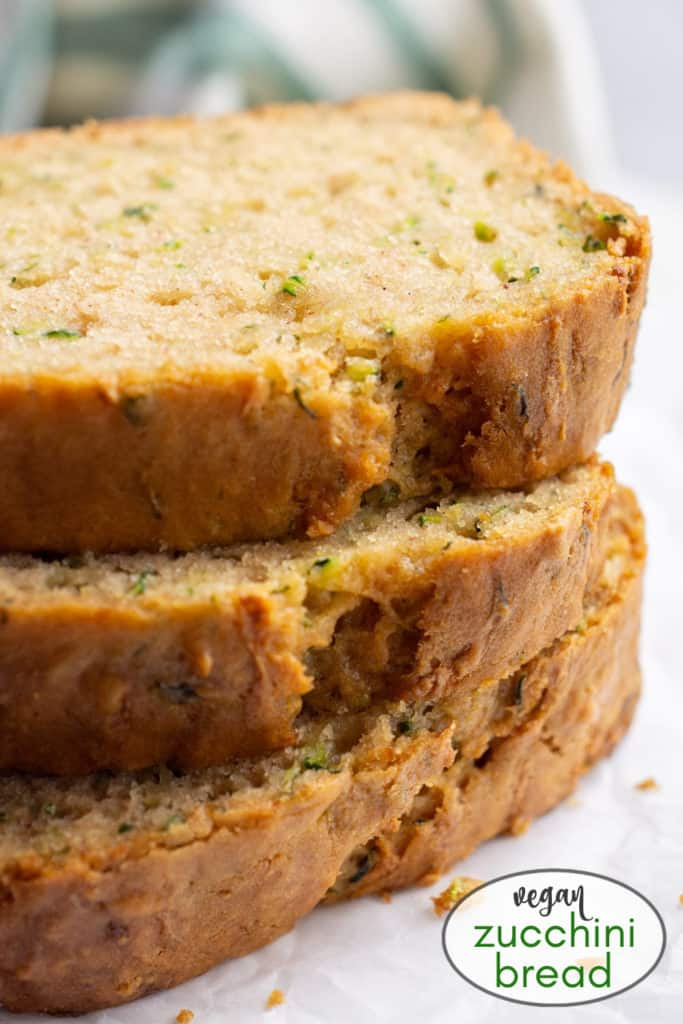 3 stacked slices of vegan zucchini bread.