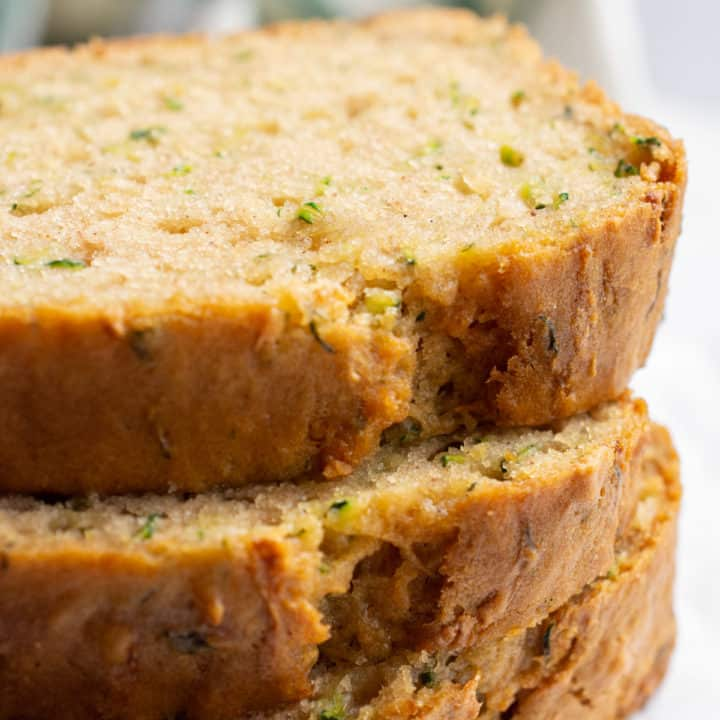 3 stacked slices of zucchini bread.