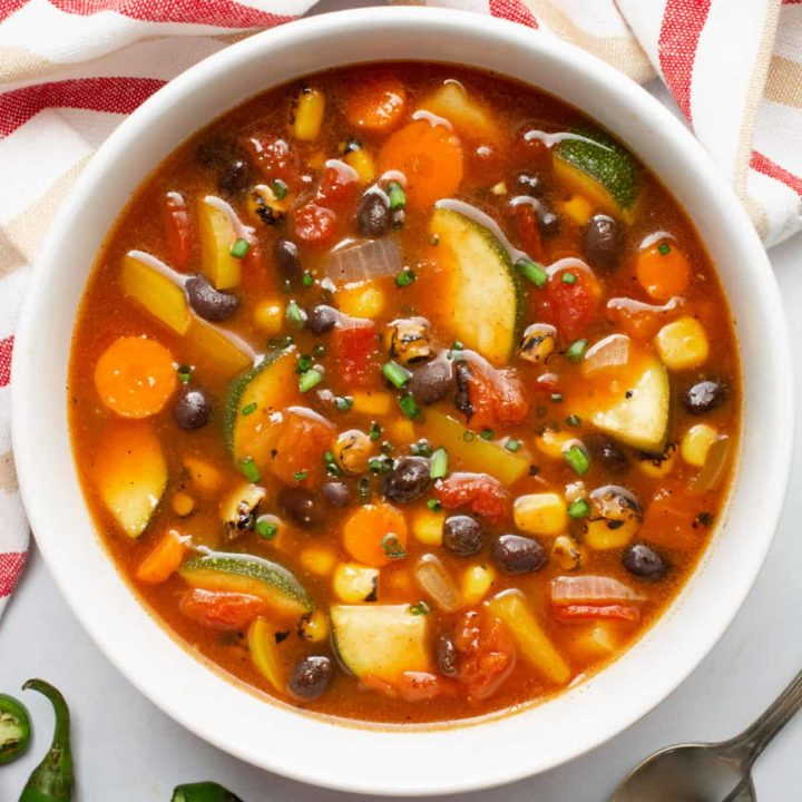 A top image of a bowl of southwest vegetable soup.