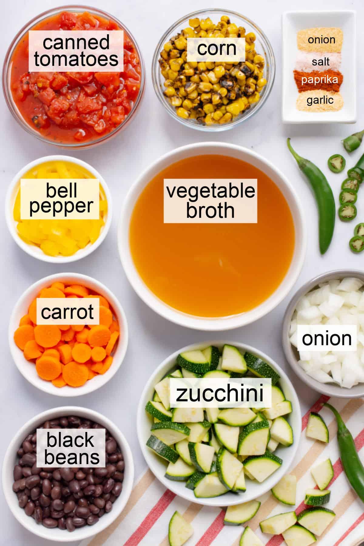Multiple bowls of ingredients for vegan southwest vegetable soup.